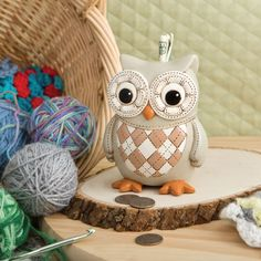 Charming and whimsical, this adorable owl bank is the perfect tool to teach your child about saving. The polyresin owl is hand-painted with a vintage design that is perfect for a girl or a boy.