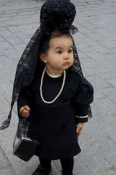 Little girl with mantilla in Seville's Holy Week, Spain.