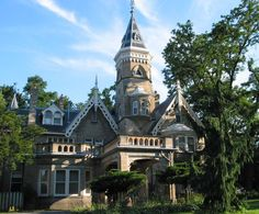 Oaklands Mansion built 1860 is now part of De La Salle College. It was built for Senator John Macdonald and is a distinctive brick Gothic revival building. The soaring tower is particularly well detailed with its lower bay window and tiny dormer windows, and fine wood trim.