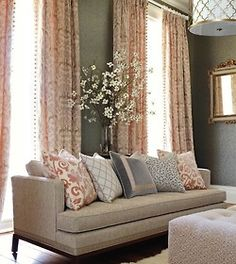 "B-O-R-I-N-G! Neutral living room. Floral accents in the same colors. Nothing here that says ""Look at me"" or ""I'm alive""."