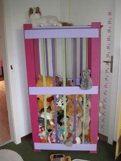 I have something similar pinned already, but the use of elastic exercise bands here is inspired  IKEA Hackers: Zoo storage for furry friends