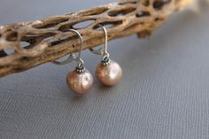 Check out this item in my Etsy shop https://www.etsy.com/listing/487725708/rare-metallic-luster-round-pearl
