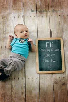 Newborn photo idea with name, weight, date, time on chalkboard.
