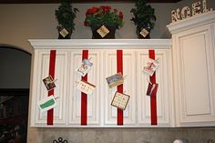 Ribbons on the Cabinets but instead of plane clothes pins use one of the painting ideas - like gingerbread man or funky red and green PAINTED clothes pins. LOVE this. DO THIS next year.
