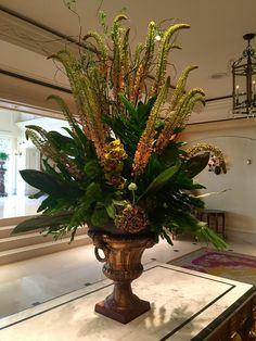 Lobby arrangement created by Tina Turner of TPG Floral Department. Come see a new & original design every Wednesday!