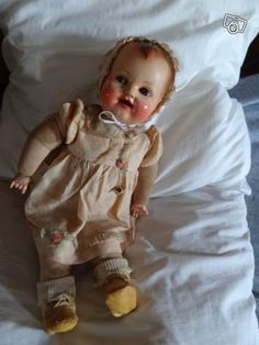 French Raynal doll looks like my baby even with the red cheeks!
