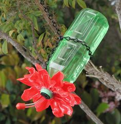 How-To Make a Plastic Spoon & Bottle Hummingbird Feeder - This would be fun for the kids to make.