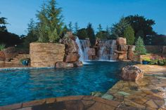 Rock waterfalls are another common feature. They establish a tropical resort-like theme and can be custom designed to the exact size you want for your yard, pool, or pond. Photo courtesy of Caviness Landscape Design, Inc.; Photograph by K.O. Rinearson
