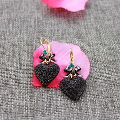 ファッションスタッドイヤリング2014新しいファッションと純粋で新鮮でエレガントな契約黒心フルドリル女性のイヤリング130827