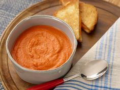 Roasted Tomato Bisque : Jeff Mauro's thick and rich-tasting tomato soup might fool you into thinking it's loaded with cream. Actually, there's just a dash — 1/4 cup for the entire recipe.
