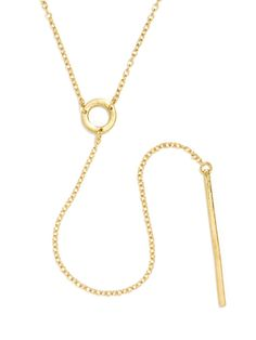 Minimal geometric elements compose this long necklace affixed with a circular charm and a long sleek bar.