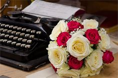 Traditional red and ivory rose bridal bouquet, filled with babys breath, great for a Winter wedding.