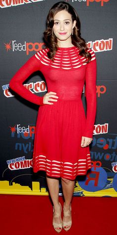 Emmy Rossum greeted fans at Comic Con in a red Temperley London dress that she styled with drop earrings and patent leather Jimmy Choo sandals.