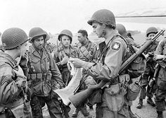 American paratroopers of the First Allied Airborne Army receive a final briefing from their officer before boarding their transport planes on September 17, 1944.
