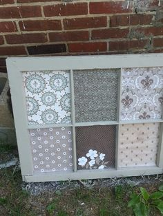 Repurposed window frame with scrapbook paper. put metal on the other side and use magnets for pictures