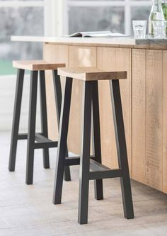 The classic design of the Rax black tall stool makes it a stylish addition to any kitchen, island or bar. With a beautiful moulded oak seat and long beech legs painted in contemporary carbon black wit Tall Stools, Rustic Stools, Wooden Bar Stools, Wood Stool, Modern Stools, Wooden Stool Designs, Diy Stool, Metal Furniture, Furniture Design