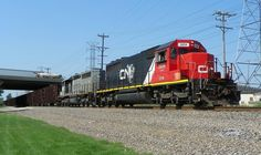 In August of 2012 CN O480 heads south on the CN Leithton Subdivision with a pair of GTW SD40-2's one in CN paint the other in KCS paint. Taken in Plainfield Illinois.  #trb_express #train_nerds #trains_worldwide #rsa_theyards #daily_crossing #pocket_rail #railways_of_our_world #grandtrunkwestern #canadiannational #plainfield #illinois by larry84988