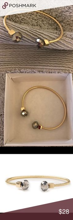 "Just In 🍀NWT Gold Tone crystal cuff bracelet The perfect cuff bracelet -gold tone flexible cuff light & comfy with grey crystal glass Premier Designs , NWT in package, took out only for pics & model, 6-1/2"", comes with the box Premier Designs Jewelry Bracelets"