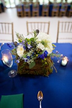 Forest-inspired centerpieces with moss accents. Perfect for a fall wedding at Airlie Center in beautiful Virginia! www.airlie.com Julie Renee Photography