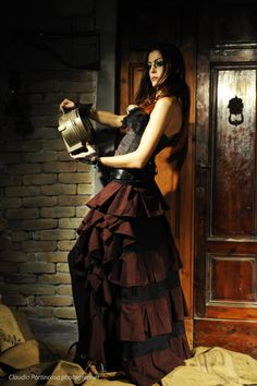Portrays a moment in which she holds an old railways light: unconscious eye on the future. The bicolored skirt is inspired by steampunk style. #victorian #steampunk #skirt #corset
