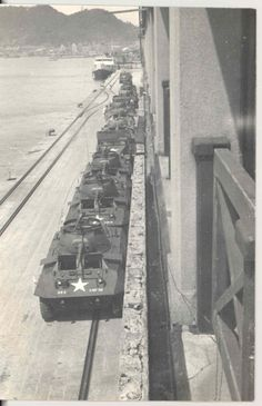 M-8 Grey Hounds being unloaded dockside and later, on patrol through occupied Japan. Circa 1946.
