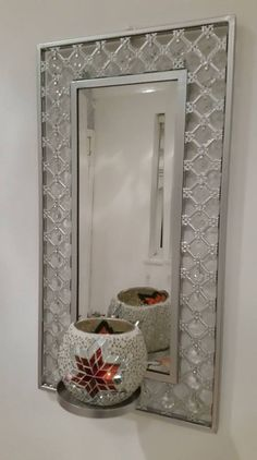 The mirror has lovely clear bead and intregate cutwork design around it with an attached plate for the candle holder. The candle holder is a hand made mosaic design and is approx 10cm.   eBay!