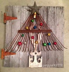 Rustic Christmas decor--use an old rake as a tree!