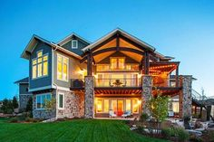 Traditional House Plan with Craftsman Touches - 95023RW | 1st Floor Master Suite, 2nd Floor Laundry, Butler Walk-in Pantry, CAD Available, Craftsman, Den-Office-Library-Study, Loft, Luxury, Media-Game-Home Theater, Northwest, PDF, Photo Gallery, Premium Collection, Sloping Lot, Traditional | Architectural Designs