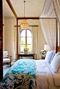 Mexican otomi coverlet on canopy bed; empire chandelier