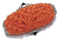 Red Coral Brooch in Art Deco Style from the 1920s  http://enchantment-jewellery.com/coral-jewellery-reefs-rings-and-responsibility/