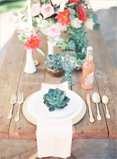 Like the napkin hanging off the edge of the table topped with a small succulent to hold the menu in place.