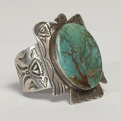 """Posted as """"Large Zuni Thunderbird Bracelet"""" This bracelet looks more like Navajo work and the stone looks like it is stabilized turquoise."""