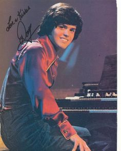 Donny Osmond - memories!  ha ha.  I used to kiss his poster!  Ba ha!!  and my sister said I couldn't like him because Jimmy was closer to my age.