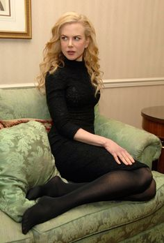 Nicole Kidman in black pantyhose with bare feet.
