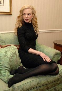 Nicole Kidman in black pantyhose with bare feet.