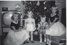 christmas 1960... (this could have been us at the house on 7th street if we'd been sisters, and rich......anyway both of those dolls look awfully familiar. ya think?)