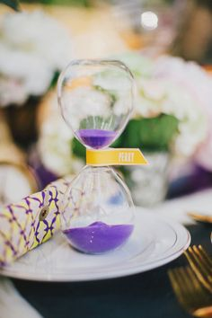 tick tock sand clock placecards // photo by Renee Nicole Design + Photography - View more http://ruffledblog.com/time-travelers-wife-wedding-ideas/