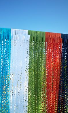 Curtains-no curtain rod required. These designer panels have a clever tab Velcro closure-so you can easily hang in places where curtain rods just won't work. Each panel is cut by a laser to create the striking pinwheel-pattern. Hang them to add a pop of color and a sense of privacy to any outdoor space.