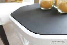chalkboard paint on glass table top, GENIUS!  Will be doing this on the ugly glass patio table :)