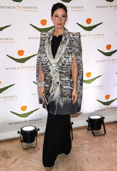 Lucy Liu attended the 2012 Women for Women in New York City wearing a lovely black gown and a stupid looking Robert Cavalli cape.