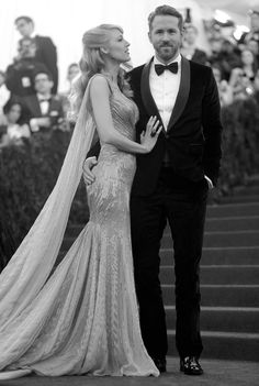 He looks like a man that knows what he has by his side, and she looks like a woman adorn.