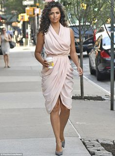 All dolled up!Camila Alves, 34, looked glamorous in a feminine frock and grey pumps while fueling up on tea in New York City on Monday