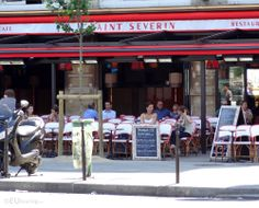 This photo shows one of the cafes at the Place Saint Michel Square known as Saint Severin, showing people sitting down at the cafe relaxing.  More information and details at www.eutouring.com/images_place_saint_michel_square.html People Sitting, Saints, Image, Cafes