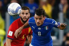 Spain's defender Nacho (L) vies with Italy's midfielder Alessandro Florenzi during the WC 2018 football qualification match between Italy and Spain on October 6, 2016 at the Juventus stadium in Turin / AFP / Marco BERTORELLO