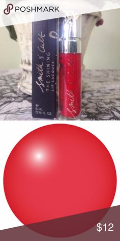 SMITH & CULT The Shining Lip Lacquer - The Warning SMITH & CULT The Shining Lip Lacquer - The Warning    Infused with Portulaca Pilosa extract that moisturizes and plumps for a more youthful-looking pout.                         The Warning- a sheer, cheery red flecked with fine-milled gold shimmer                                                          Full Size .16 fl oz                                                         New unused in box. Smith & Cult Makeup Lip Balm & Gloss