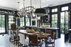 WINDSOR SMITH -- A midnight-blue kitchen features marble floors and countertops, mercury-glass backsplashes, and chandeliers hanging from a white tin ceiling. Kitchen Inspirations, Kitchen Design Open, Decor, Interior Design, House, Beautiful Kitchens, Home, Dining, Kitchen Design