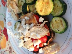 "Grilled portabella ""pizzas"" with grilled tomatoes and chicken. Zucchini on side. #primal #paleo"