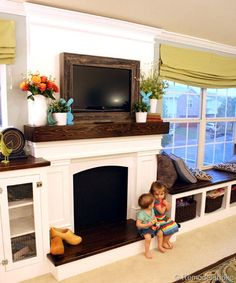 fireplace between lounge windows with bench seats