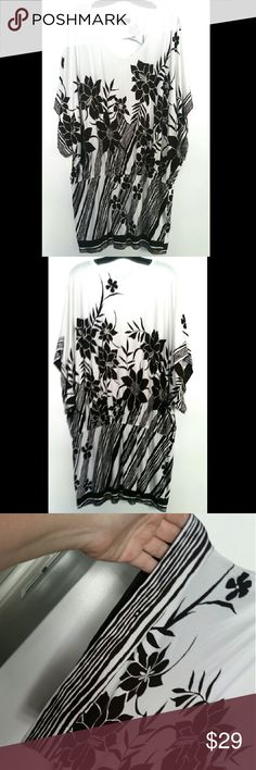 """Karen Kane XL Floral Tunic This Karen Kane XL Floral Tunic is in good used condition. Super soft and stretchy. Wide sleeves. Bust measures 25"""" across laying flat, measured from pit to pit, so 50"""" around. Elastic at waist. 94% rayon, 6% spandex. 37"""" long. No pilling or stains. Made in USA! HOORAY! ::: Bundle 3+ items from my closet and save 30% off when you use the app's Bundle feature! ::: No trades. Karen Kane Tops Tunics"""