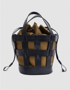 b247fffd686b Cage tote bag in Black Leather. Two top handles. Removable satin insert  with suede